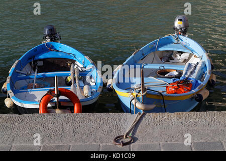 VERNAZZA, Italy, June 4, 2017 : Two small boats in the harbor of Vernazza, a village of the Cinque Terre National - Stock Photo