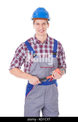 Happy Worker Holding Toolkit And Wrench Over White Background - Stock Photo