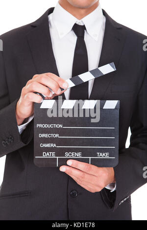 Close-up Of A Businessman In Suit Holding Clapper Board - Stock Photo