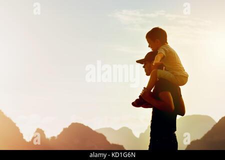 Happy father son travel flight concept - Stock Photo