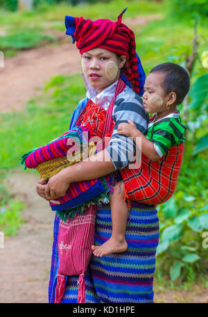 Portrait of Intha tribe woman in Inle lake Myanmar - Stock Photo
