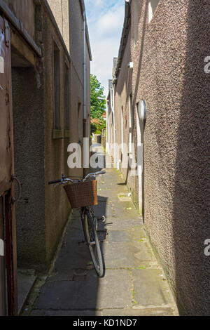 A bicycle in a narrow side street off Albert Street, Kirkwall, Orkney Mainland, Scotland, UK. - Stock Photo