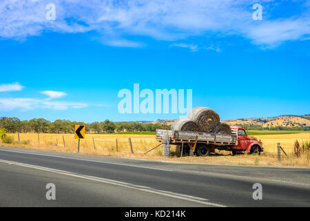 Adelaide, Australia - January 16, 2016: Old abandoned truck with hay near Moorooroo Park Vineyards in Barossa Valley, - Stock Photo