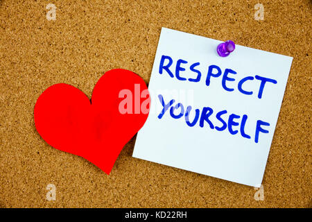 The phrase Respect Yourself in red text on a lined index card pinned to a cork notice board as reminder - Stock Photo