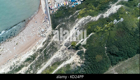 Aerial top down view from a white cliff to the beach in Hastings, Southern England - Stock Photo