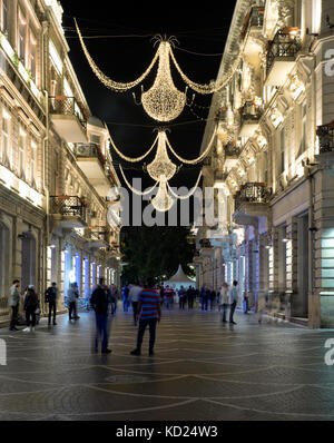 Baku, Azerbaijan - May 18, 2017 : Nizami street in the city center illuminated by night. - Stock Photo