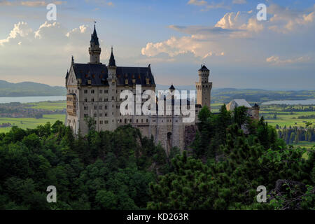 Back behind shot of Neuschwanstein Castle and valley, near Füssen in southwest Bavaria, Germany. - Stock Photo