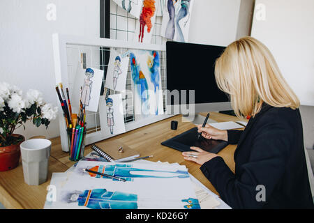 designer using graphic tablet - Stock Photo