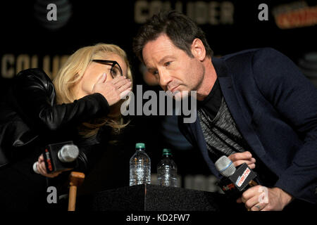 New York, USA. 8th Oct, 2017. Gillian Anderson and David Duchovny speak at The X-Files panel during the New York - Stock Photo