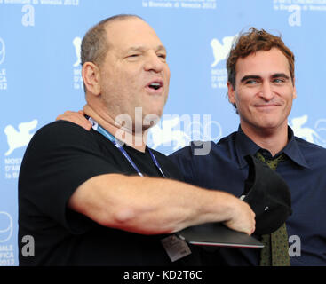 Venice, Italy. 01st Sep, 2012. US film producer Harvey Weinstein (L) and US actor Joaquin Phoenix pose during a - Stock Photo