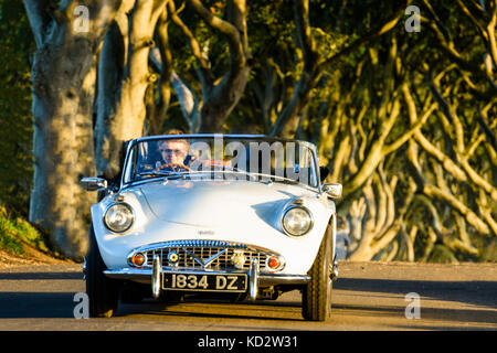 Armoy, County Antrim. Northern Ireland.  10/10/2017 A white Volvo sports car drives along the Brenagh Road, home - Stock Photo