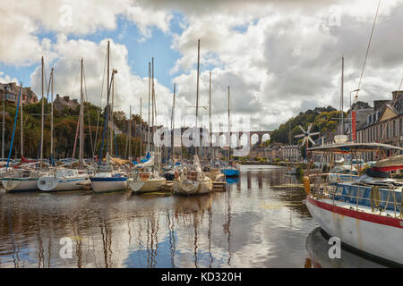 City of Morlaix, Brittany, France. Marina in foreground and viaduct in back. - Stock Photo