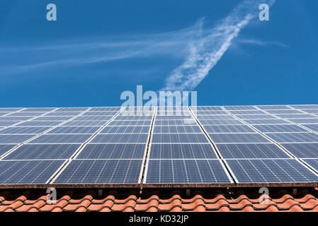 Solar panels on roof, low angle view, Munich, Germany - Stock Photo