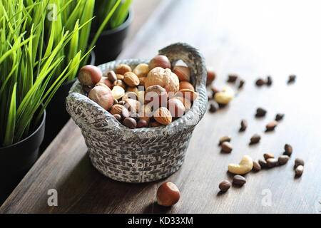 tasty nuts on a wooden table - Stock Photo