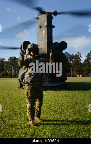 U.S. Army Spc. Ira Duville, a maintainer and crew chief with the South Carolina Army National Guard's 2-238th Aviation - Stock Photo