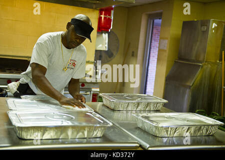 Retired South Carolina Army Guardsman Bernard Sherman provides dinner for guardsmen staying at the Georgetown, S.C., - Stock Photo