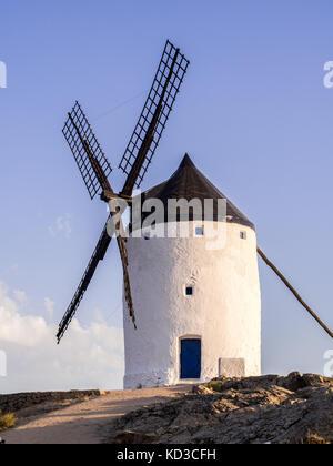 Windmill (molino) in Consuegra, Toledo Province, Castilla La Mancha, Spain, at sunset. - Stock Photo