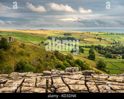 View over Malhamdale from Malham Cove Yorkshire Dales England - Stock Photo