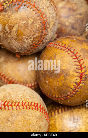 Several Worn Out Old Baseballs in a Pile. - Stock Photo