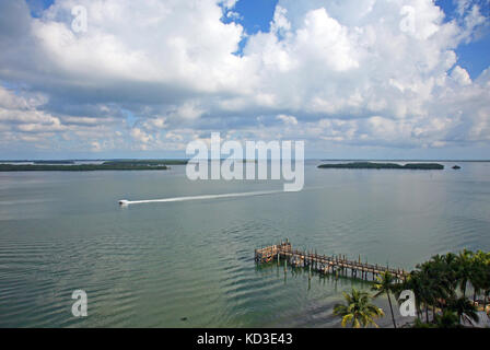 A speedboat cruises by the Sanibel Harbour Resort in Fort meyers, Florida - Stock Photo