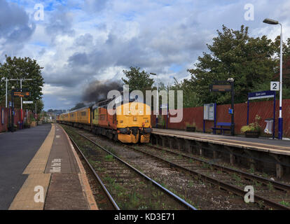 Colas Railfreight class 37 locomotive passing Bare lane (Morecambe line)with a Blackpool North - Derby Network rail - Stock Photo