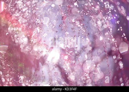 Multicolored spray fountain at night - Stock Photo