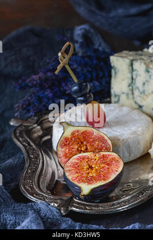 Half of ripe figs with Gorgonzola and Camembert. Close-up. Village. - Stock Photo