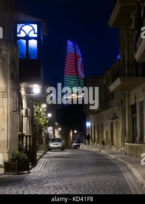 Baku, Azerbaijan : Icheri Sheher (Old Town) by night, Flame tower in background - Stock Photo