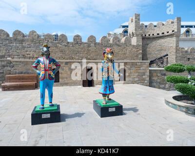 Baku, Azerbaijan - May 18, 2017 : 4th Islamic Solidarity Games mascots next to Old City walls - Stock Photo