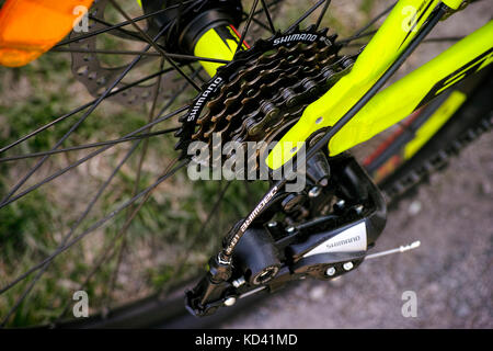Tambov, Russian Federation - May 07, 2017 Shimano gear cassette on rear bicycle wheel. Closeup. - Stock Photo