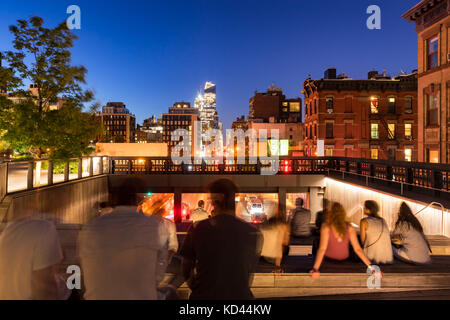 A summer evening at the Highline overpass lookout (High Line Park). 10th Avenue, Chelsea, Manhattan, New York City - Stock Photo