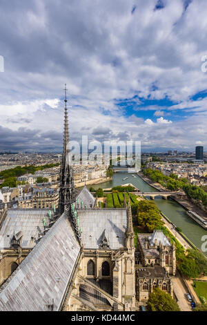 Elevated view of Notre-Dame de Paris with the Seine River Banks and Paris rooftops. Paris, France - Stock Photo