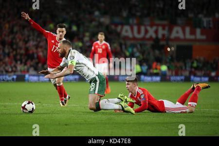 Wales' Ben Woodburn fouls Republic of Ireland's David Meyler during the 2018 FIFA World Cup Qualifying Group D match - Stock Photo
