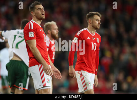 Wales' Sam Vokes and Aaron Ramsey look dejected during the 2018 FIFA World Cup Qualifying Group D match at the Cardiff - Stock Photo