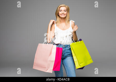 Happy woman enjoying successful shopping. Woman with shoping bags on white. - Stock Photo