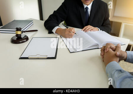 Judge gavel with Justice lawyers Plaintiff or defendant  meeting at law firm in background. Concept of law. - Stock Photo