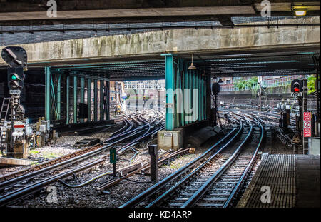 London Underground tube train tracks, with the entrance / exit to an overground station, despite most of the route - Stock Photo