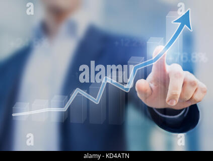 Businessman presenting a sustainable development concept, concept with chart going up showing growth, profit or - Stock Photo