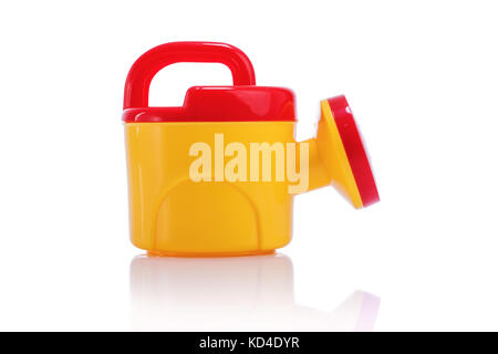 Child's plastic watering can isolated on white background - Stock Photo