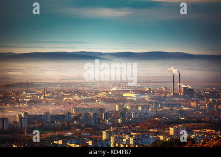 Sunrise view on the city from above - Stock Photo