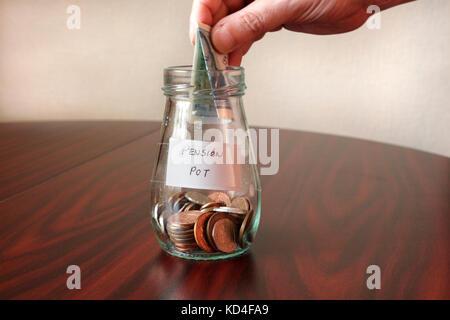 Adding to the Pension Pot - Stock Photo