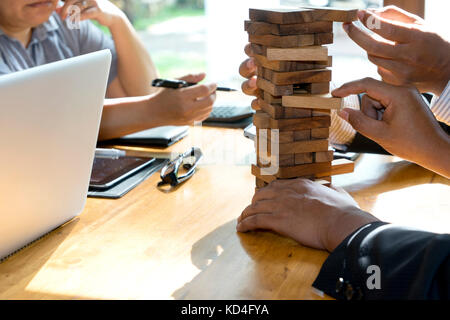 man and woman play wood material toy block for develop thinking and activity Stock Photo