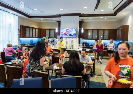 Washington DC District of Columbia Homewood Suites by Hilton hotel dining room free breakfast buffet family eating - Stock Photo