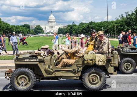 Washington DC District of Columbia National Memorial Day Parade staging area float WWII Jeep re-enactors Capitol - Stock Photo