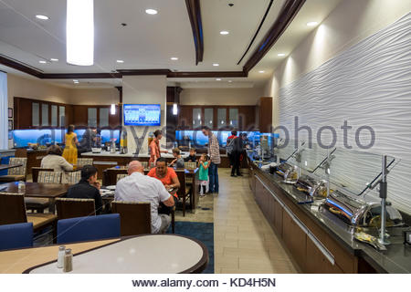 Washington DC District of Columbia Homewood Suites by Hilton hotel dining room free breakfast buffet eating interior - Stock Photo