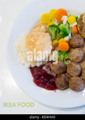 A plate of IKEA meatballs, mashed potatoes, cream gravy, lingonberry sauce, mixed vegetables and a potato-vegetable - Stock Photo