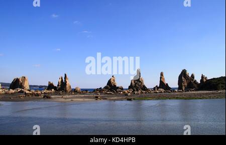 Hashigui-iwa or bridge pillar rocks were created by the famous monk Kobo Daishi. A series of rocks dot the coastline - Stock Photo