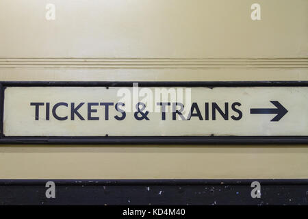Tickets and Trains, vintage old underground train sign, Aldwych Tube Station Subway, London - Stock Photo