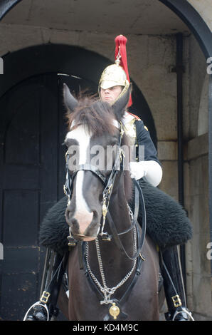 London  United Kingdom  -1 October  2017: Queens life guard soldier on horseback on guard duty - Stock Photo