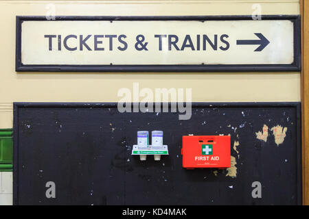 Tickets and Trains, vintage old underground train sign with health and safety first aid box, Aldwych Tube Station - Stock Photo